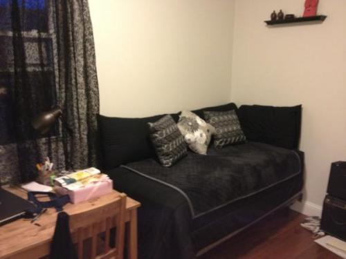 Check out Lisa's single-bed-as-daybed solution! We think it looks super comfy and we're into the dark colours.