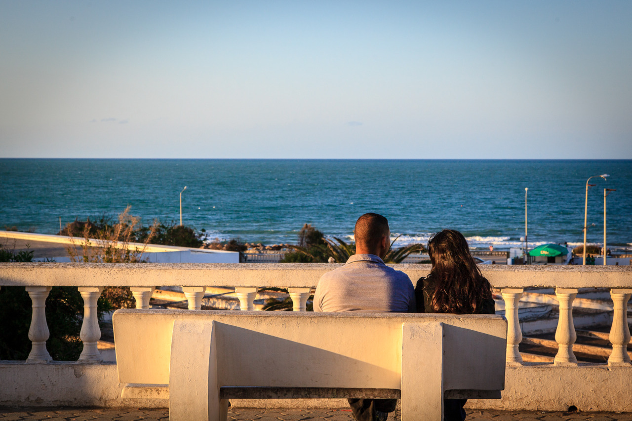 Watching the sea   A couple sits and watches the Mediterranean on the corniche in La Marsa, Tunisia. (by Omar Chatriwala)