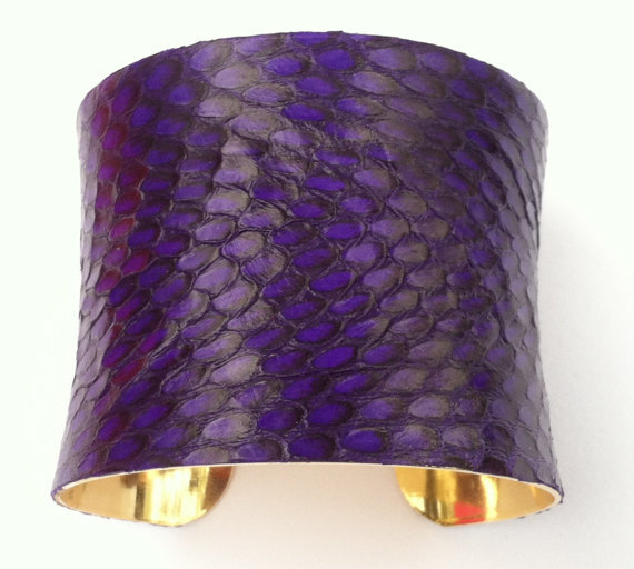 Nice bit of snake!  Royal Purple Snakeskin Cuff Bracelet, Leather Cuff Bracelet Stunning Royal Purple REAL Snakeskin Leather Cuff Bracelet with a Gold tone Metal Cuff lining. Hand dyed Real Snakeskin with this Rich Royal Purple. Each bracelet will have it's own unique markings because no two snakeskins are alike. This cuff fits size 5 (Loose fit) -8 inch wrist and is adjustable with a gentle closing or opening. It measures just under 2inches in height. Convo me with any questions. Thank you for looking!!Stormy $65.00