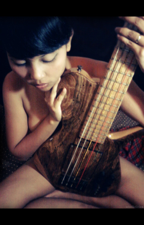 "12 May 2012 Me and my partner's bass Alessandra (an Elegee custom). Photography and lighting by her, in fact this was all her idea—I was innocently ""playing"" the new SX (still nameless) when she sprung this on me. Phonecam, though, so I had to post-process to improve the quality a bit. Kind of a teaser, there's more but not really sharing the rest (maybe just one or two).Thank you kindly. ♥"