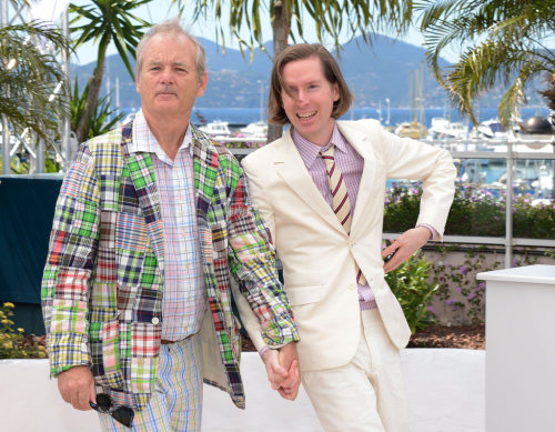 not gonna lie, i kinda loves me a white/cream suit… cussyeah-wesanderson:  Bill Murray and Wes Anderon holding hands and looking beautiful.