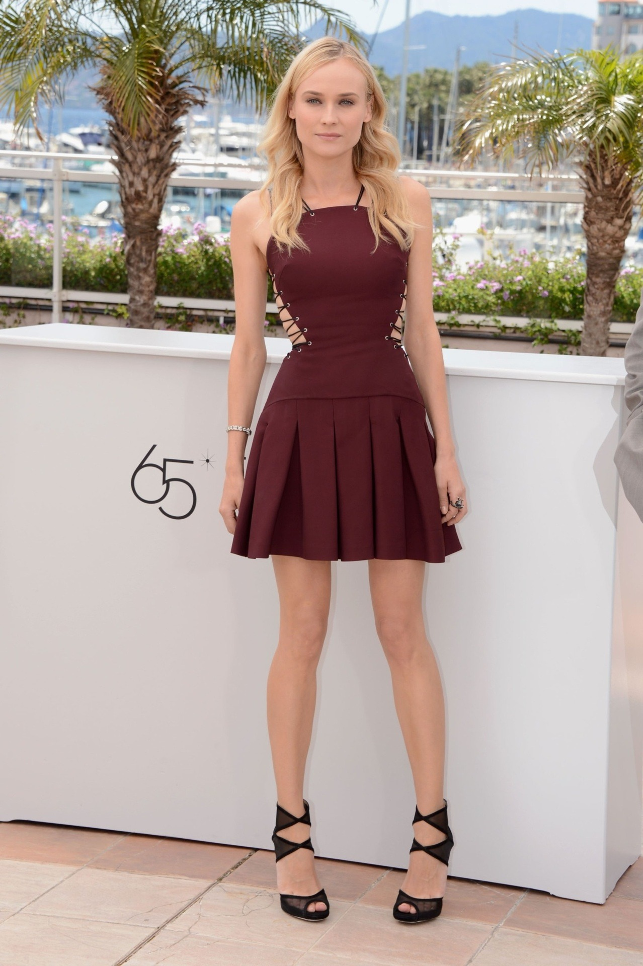 suicideblonde:  Diane Kruger in a Versus mini dress and Jimmy Choo strappy sandals at the Cannes Juror Photocall, May 16th  This dress!