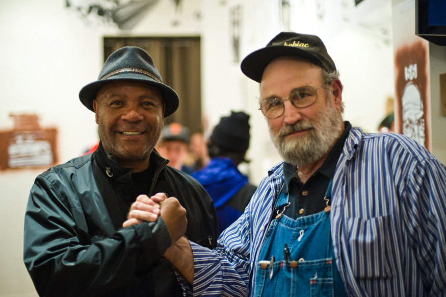 Emory Douglas & buZ blurr connect at my old store/gallery back in 2008. Photo by the homie Shaun Roberts And, for those who care about such things, here's an interview that I did with buZ around that same time: 2 Sides To Every Boxcar  I hired out in '62 and didn't start marking the cars until November '71. So that nine-year interim I was working various night jobs, and I had given up my idea on any kind of art, and had started reading novels like Vonnegut's; all his greatest novels featuring his Kilgore Trout character—a writer that didn't have readers, but he continued writing compulsively. I was also reading 'Understanding Media' by McLuhan, RD Laing's 'Politics of Experience,' and those other heavy thinkers like Skinner and the conditioned response of his experiments and all that. So during all this time I had been in an afternoon job—it was one of the first times I'd had a regular daylight job—and most times I was working at night on switch engines and locals. So on this job I was working what they call the long field position, and I was down in the yard—the rail yard was downhill—and I had to keep the tracks from rolling out the north end so I had to keep the head brakes tied down on all the rails. So after I had that done, I was just laying down in amongst the cars to make certain they didn't roll out. I had some free time so I decided to be a vandal myself, you know?