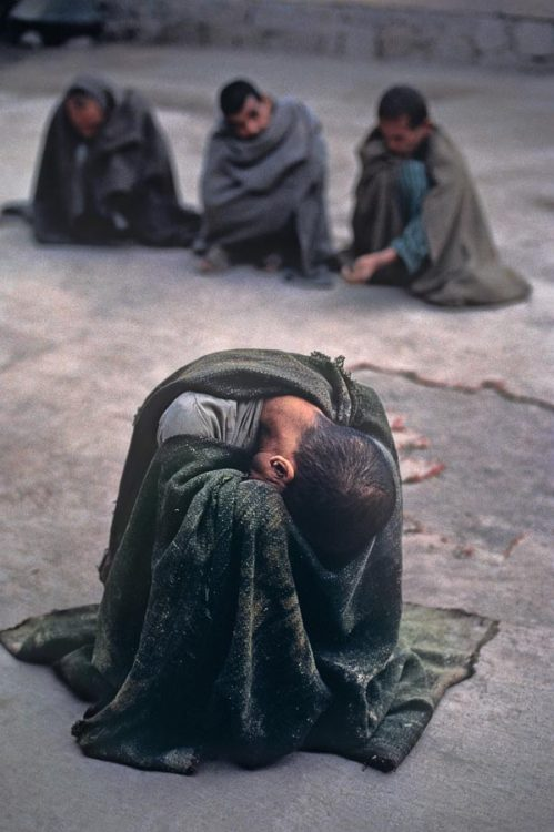 "Insane asylum, Kabul, Afghanistan ""The pain of war has become too much for these men. Wrapped in blankets, they have retreated into themselves. Vulnerable and haunted by demons, they are the uncounted casualties of decades of war."" - Steve McCurry"