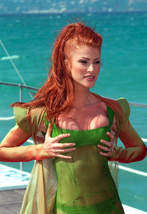 Angie Everhart bringing some much needed genie in a bottle fetishism to Cannes in 1997.