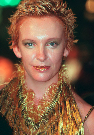 Toni Colette in costume as a sweaty, greasy golden awards statue at the 1998 Cannes Film Festival.