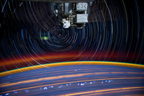 "kqedscience:  Picture of the Day: Star Trails From the International Space Station ""Astronaut Don Pettit created this image of star trails as seen from the International Space Station approximately 240 miles above Earth. He explains, ""My star trail images are made by taking a time exposure of about 10 to 15 minutes. However, with modern digital cameras, 30 seconds is about the longest exposure possible, due to electronic detector noise effectively snowing out the image. To achieve the longer exposures I do what many amateur astronomers do. I take multiple 30-second exposures, then 'stack' them using imaging software, thus producing the longer exposure."" The above picture combines 18 such exposures."""