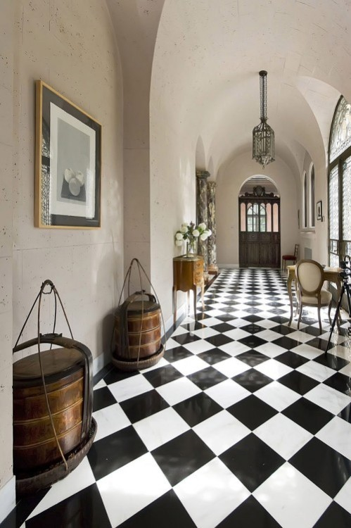 Entry hallway with arched barrel ceilings and a classic black and white checkerboard tile floor (via Inspiring Places & Spaces / gorgeous)