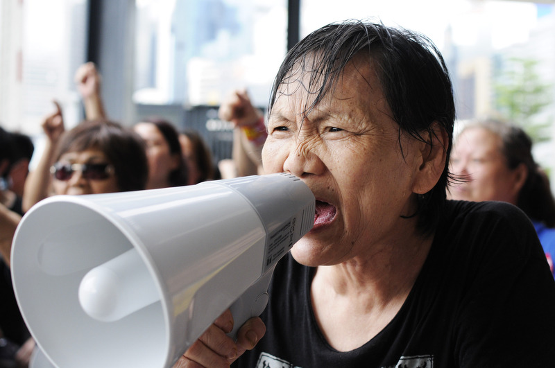 HONG KONG: (May 16, 2012) — An elderly woman protests against the filibuster by radical lawmakers on government's controversial by-election bill outside of Legislative Council (LegCo) Complex. Legislators slog through the early stages of an all-night debate inside the chamber. The People Power submitted 1306 amendments attempting to forbid resigning lawmakers from participating in by-elections.  Two consecutive meetings were adjourned in accordance with the rules of procedures, which require a quorum of 30 members (one half of all members), when most pan-democrats boycotted the meeting. (Justin Chin/www.justinchin.ca)