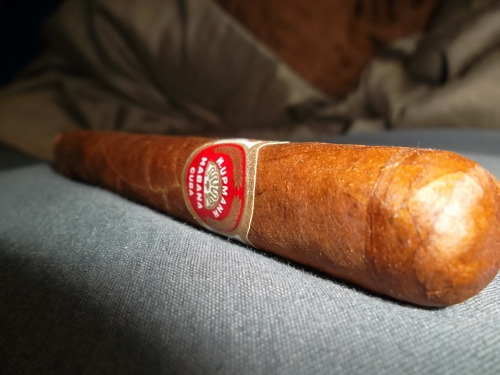 """H.Upmann"" in corona (Cuban) This $10.00 cigar had a dark tan wrapper with a visible oil sheen to it, showing medium sized veins with no tooth and a slight box press. The pre lit aroma consisted of wood and pepper notes. The ash was a dark grey color which stacked wonderfully holding on an inch to an inch and a half at a time. The burn however was slightly wobbly. Upon lighting this cigar, I noticed flavors of wood and a milk coffee  sweetness on the draw with an earthy and peppery finish. The draw itself was on the firm side however it was providing a ton of rich medium bodied smoke. This cigar was very consistent, never changing its flavor profile until the last third where a nutty flavor note was starting to dominate the flavor profile. To me this cigar is the ""typical"" everyday cuban cigar with great cuban flavors as well as smoothness that can definitely be associated with a number of great brands from Cuba. A wonderful cuban cigar at a fair price! Stay Toasting!"
