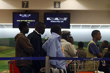 Migrants from Sudan wait in-line for a security check before boarding a flight at Ben Gurion airport near Tel Aviv, Israel, late Monday, Dec. 12, 2010. An official familiar with the operation says 150 Sudanese who illegally entered Israel were flown back to their war-torn homeland in a secret operation. (Associated Press/Uri Lenz) (http://www.csmonitor.com/World/Middle-East/2010/1214/Israel-repatriates-150-Sudanese-in-broader-effort-to-discourage-African-influx)