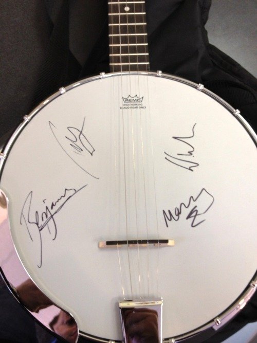 Fancy a banjo, signed by each member of Mumford & Sons? This banjo is being auctioned off with all the proceeds going to support WFUV Radio, a non-commercial, listener-supported radio station at Fordham University in New York.  The auction ends on May 23, 2012 at 6:00 PM EST. If you've got a few hundred dollars laying around, click through to place your bid!