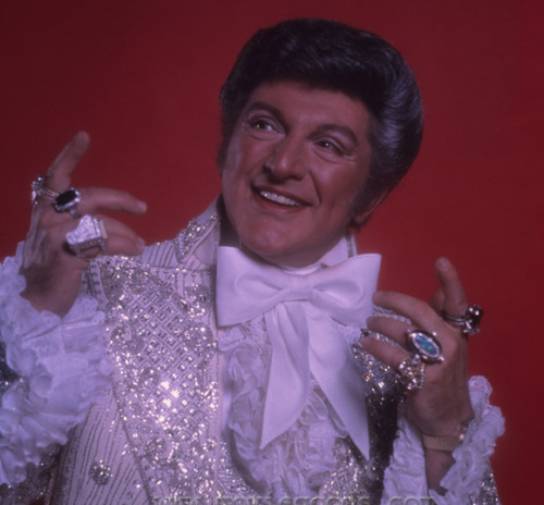 His name was Wladziu (or Vładziu) Valentino Liberace, but we knew him best by just his last name and flamboyance. He was born on this day, May 16, in 1919, which means he would have been 93 if he were still alive. Liberace died in 1987, but his career  spanned four decades of concerts, recordings, motion pictures, television and endorsements…. During the 1950s–1970s he was the highest-paid entertainer in the world and embraced a lifestyle of flamboyant excess both on and off the stage [Wikipedia]