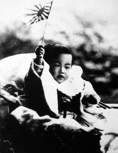 Hirohito/Emperor Shōwa of Japan as an infant waving a flag, 1902.