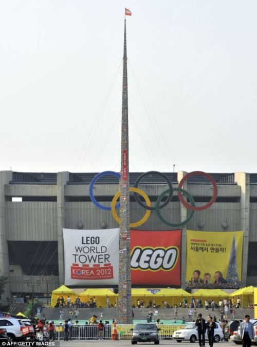 "Seoul's 105-foot Lego tower marks 80 years of stacking colorful plastic bricks. Graphs, charts, comparisons of the Lego gender imbalance through the years. ""Can you see any clippy bits?"" Panel of kids explain their strange names for each Lego piece."