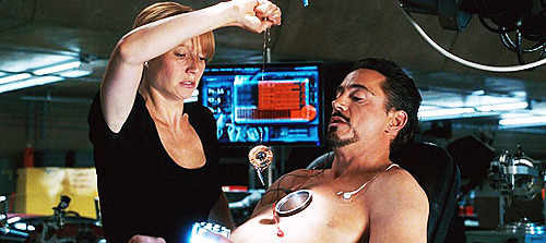 The scene where Pepper helps Tony replace his arc reactor was filmed using a prosthetic chest, joined to Robert Downey Jr.'s own chest and projecting out at an angle, while Robert was 'in' the back of the seat he was sitting on. A bright light was positioned shining on the area to hide any potential 'edges' of the fake chest-piece.
