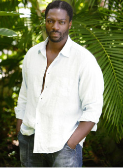 theblackme:  AFRICA: Adewale Akinnuoye-Agbaje's Puts Internalized Racism Into Focus Oz fans may remember Adewale Akinnuoye-Agbaje as the vicious convict Simon Adebisi, but the British-Nigerian actor was also featured in the hit series Lost as Mr. Eko, the reboot of horror classic, The Thing and HBO's upcoming American spy seriesHunted. While Akinnuoye-Agbaje builds an impressive rep for his onscreen talent, it's his role behind the camera that may be the most intriguing of all. Farming is the title of the film project that chronicles Akinnuoye-Agbaje's complex upbringing: A journey in which a confused, adandoned Black Brit who once was skinhead, attained a law degree, became a successful actor and learned to embrace his identity. The term farming refers to a practice common in 1960's-70's Britain, particularly among foreign students such as Adewale's. At 6 weeks of age, the actor's Nigerian parents put him (and eventually his 2 sisters) under the foster care of a working class white couple in the UK dockside town of Tilbury, while they continued their studies in London. The Andrew Anthony of The Guardian reported:……….