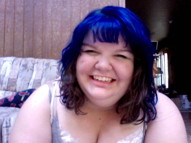 in horrible photobooth pictures news…i just dyed my hair blue! hurray!