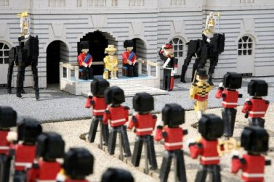 "Lego model of Queen Elizabeth II planned for Jubilee Legoland in Britain will display a 10-cm high model of Queen Elizabeth II, complete with a miniature crown encrusted with real diamonds, to mark the Diamond Jubilee. Described as ""one of the most valuable Lego models"", the Lego Queen will go on display this month on the balcony of a recreation of Buckingham Palace at Legoland Windsor's Miniland.  Specially commissioned by jewellery designer Dinny Hall, the tiny 1.5-cm tall crown is made from silver and contains 48 cut diamonds worth thousands of dollars. The Queen will be joined on the balcony by new figures of the Duke of Edinburgh, Prince Charles and the Duchess of Cornwall, the Duke and Duchess of Cambridge and Prince Harry."