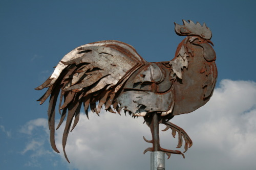 Metal rooster by John Greico at the Public Market
