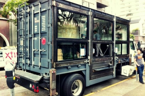"socalfood:  When a Truck Isn't Enough for Mobile Food A wood-burning oven on a food truck. How do we feel about that? It seems, at first glance, a fairly terrifying idea. I know visions of spontaneous fireballs danced in my head. Of course, food trucks don't actually cook while mobile, and they wouldn't have passed the required inspections if they were wildly, obviously unsafe. But there remains the issue of space. An entire wood-burning pizza oven won't fit on the average food truck, and this week we saw two examples of making such a thing road-worthy. Up in San Francisco, Del Popolo launched service yesterday, with just two pizzas on the menu. The vehicle, pictured above, is described as a mobile pizzeria ""housed in a twenty-foot transatlantic shipping container that's been re-purposed and modified into a kitchen."" See more here."