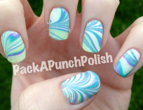Water marble with blue, purple, and yellow. The blue and yellow ended up mixing to make green.