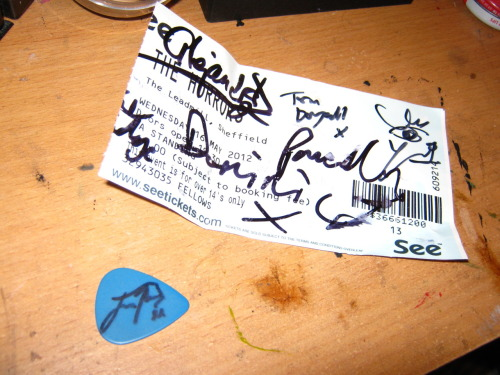 "JOSH SIGNED MY PICK. he said it wasn't the most ridiculous thing he'd ever had to sign, so that was nice. I told him that he was a massive inspiration to me as a guitarist althought it probably came out like ""aarhlhblhbarlbrl inspiration arlahrghgllgh massive alahlrgahrgliloveyoualjkhg"" but he was really sweet then he hung around chatting to our little gang of fans for a while which was so great, he's just so great ahh also I got my ticket signed by all of TOY and one of bo ningen who was especially lovely. not sure which signature is which and half of one got torn off by the ticket person but o well"