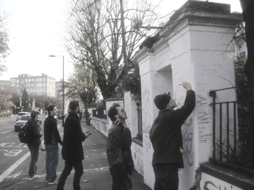Signing the wall at Abbey Road Studios.
