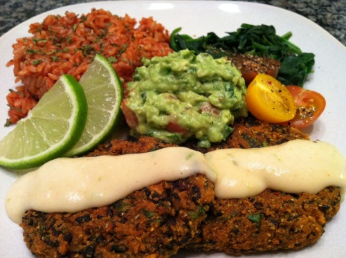 Cuban black bean cakes with lime creme, Mexican rice, and fresh guacamole. Recipe from Everyday Happy Herbivore.