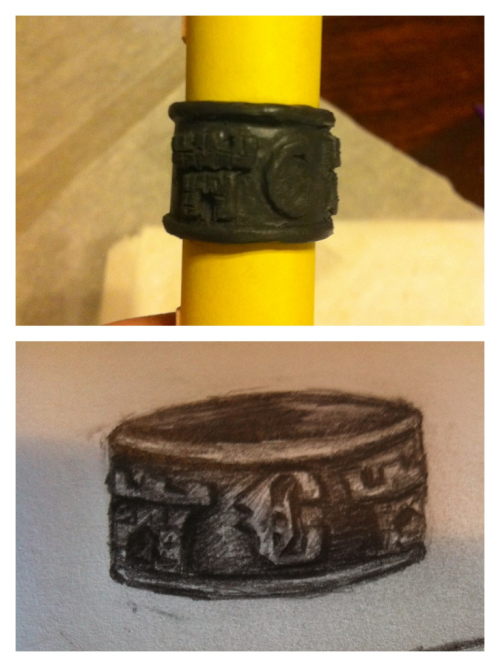 Carstairs family ring out of polymer clay for a bit that I've been working on. Its based on the drawing there that I sketched. Still figuring out how to bake this thing!!