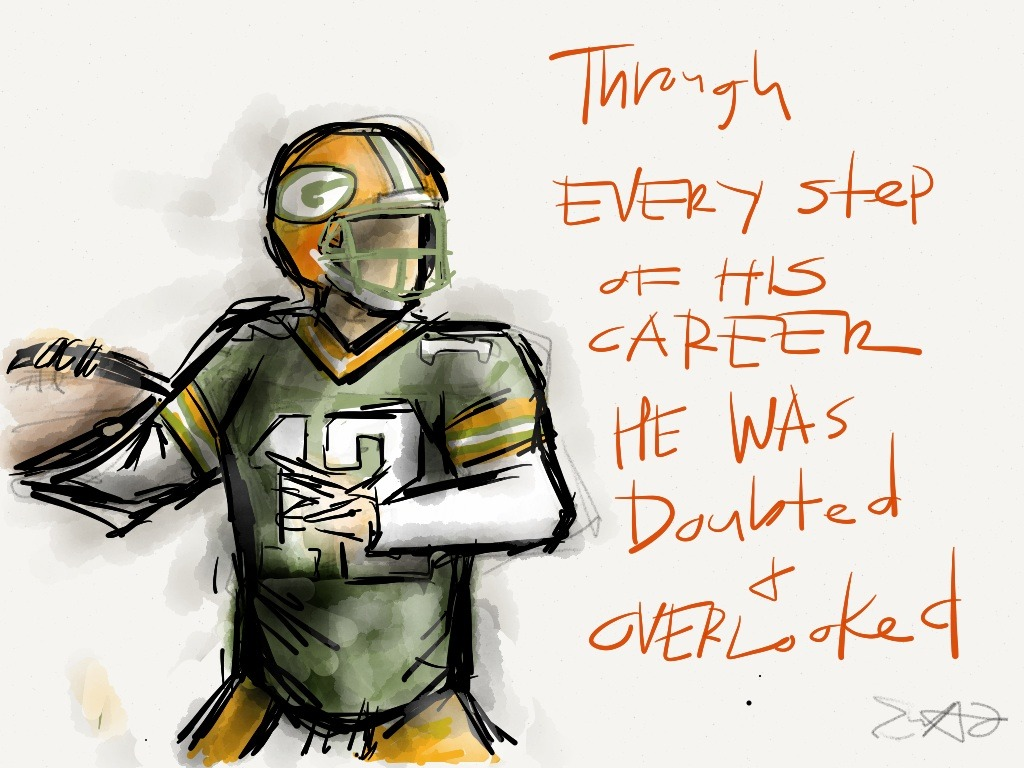 "#12 Made with Paper  You can tell alot about a person by… their favorite QB  I often turn to Aaron Rodgers for inspiration. Rejected by Division 1 schools and had to go to Jr college (not because of academic reasons), Was projected to be #1 in the 2005 draft but somehow fell to the 24th pick, waited for 3 years and had to overcome in Favre's legend. It's about to get cheesey here (pun intended) but there's a lot to relate to #12. Now I am no where close to being a quarterback, but often times in my personal life especially the major chapters I feel like I get overlooked and have to work my way to win the people over and over again. Trust me I've had a lot of doubters. Then there are other things. Just like #12 I'm a huge dork and often photobomb pictures. I even pulled out a championship belt when I won the graphic design student of the year award. I'm working as hard as I can but right now I'm just in a tough spot and it definitely feels like im falling down to the 24th pick.  ""He's had to work for everything. He knows what it's like to be overlooked. Nothing has ever been handed to him."" Read more here: http://www.thenewstribune.com/2011/12/04/1931746/no-overlooking-him-now.html#storylink=cpy"