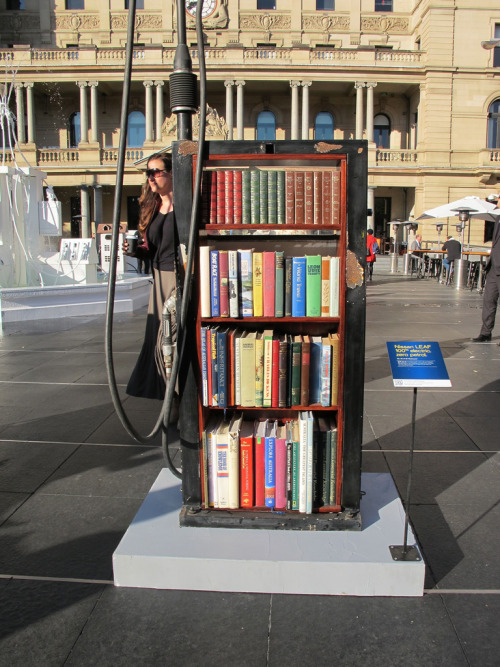 bookshelfporn:  Bookcase Petrol Bowser  An art installation by Nissan for their LEAF model in Sydney, Australia showing how petrol bowsers might be used in a 'World Without Petrol'.