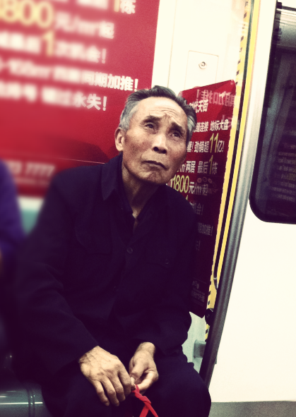 This old man on the subway was very photogenic don't you think?