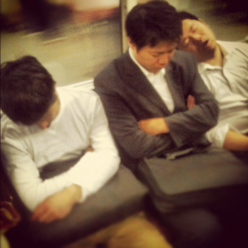 Weary salarymen on the Japanese metro. You can't get a more typical shot of Tokyo.