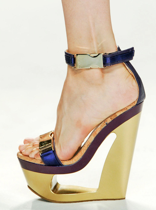 heelchorus:  » Frankie Morello gold carved platform high-heel wedge, Spring 2012. (Image: ELLE)