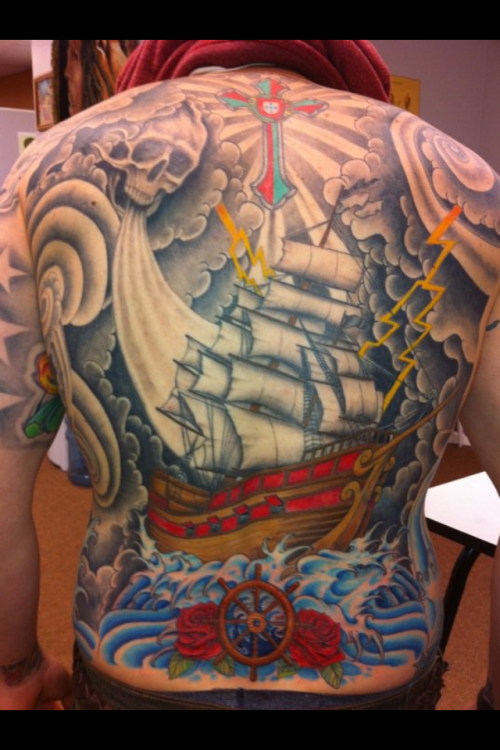 "pirate ship at sea! i took home 2nd place""best backpiece"" and 3rd place ""best overall male"" at the 2012 baltimore tattoo convention with this piece."