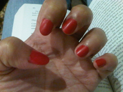 Feisty red. I don't normally paint my fingernails, I find it distracting.. Although I always thought they look great in other girls'.  Today, I'm out with my sisters and mom all getting pampered.