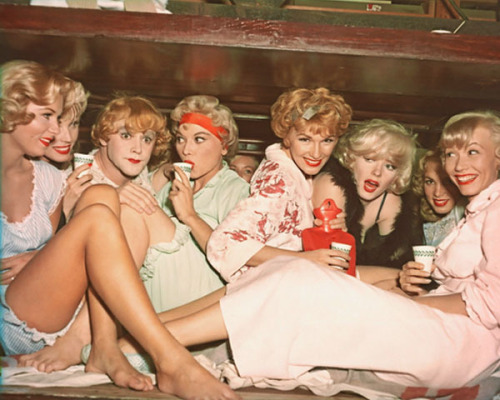 "Here is a photo of Marilyn Monroe & the 'girls' in her greatest role as Sugar Kane Kowalczyk. Make sure you see for the first time or for the 100th this brilliant, charming & hilarious movie. There have been occasions (very few) that I am on set & observe that the model may have the most beautiful skin/ face/hair/body look great in the clothes & then sometimes just sometimes an essential ingredient appears to be missing: humour/sex appeal/charisma/charm/brain/manners/personality. On the silver screen & in real life we are reminded of that memorable end line in Some Like It Hot, ""Well, nobody's perfect."""