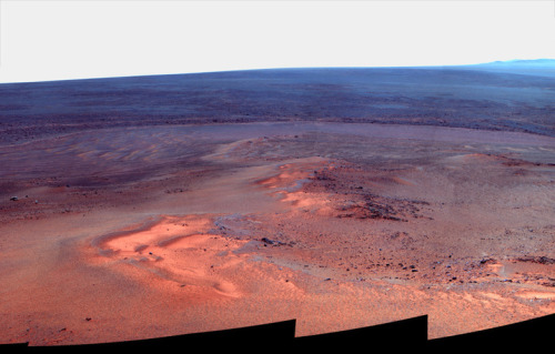 "Mars Rover Opportunity Emerges From Winter Doldrums, Gets Back On Move A mosaic of images taken in January 2012 shows Opportunity's vista north (left) and northeast (right), in an outcrop known as ""Greeley Haven,"" where the rover spent its fifth Martian winter. The image released by NASA is presented in ""false color,"" to make differences in the landscape easier to see. — With the darkest days of the Martian winter now over, NASA took its Opportunity Mars Rover for a drive this week. The rover had been stationary while its solar panels lacked enough sunlight to power its batteries. The rover's drive Tuesday was a short one: ""about 12 feet northwest and downhill,"" according to NASA. The agency says Opportunity has driven 21.4 miles since it landed on Mars in January of 2004. Opportunity's current area of southern Mars reached its winter solstice at the end of March. And that means the rover's ""break time"" is over. (via NPR)"