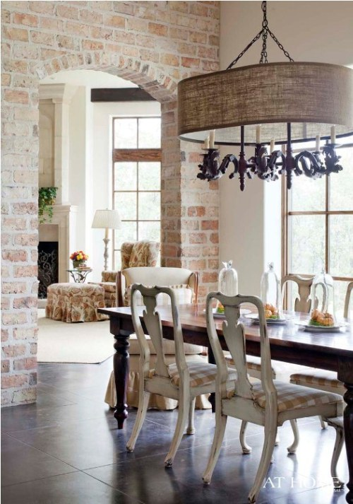 Dining room with a brick wall (via eclectic revisited by Maureen Bower)