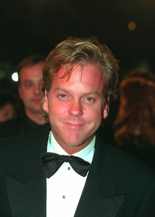 A smug and possibly drunk Kiefer Sutherland at the premiere of Dark City at the 1998 Cannes Film Festival.