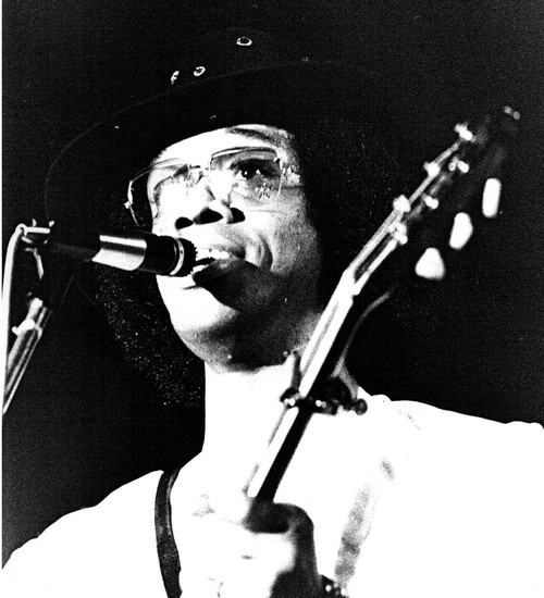 "propers to rootsnbluesfestival:  johnny guitar watson Today in 1996, blues guitarist Johnny Guitar Watson died of a heart attack while on tour in Yokohama, Japan. According to eyewitness reports, he collapsed mid guitar solo, his last words being ""ain't that a bitch."""