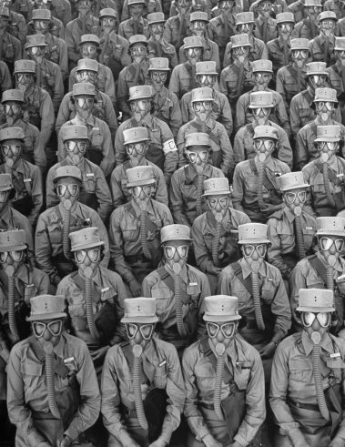 collective-history:  Row upon row of WACs (Women's Army Corps members) don gas masks for a training drill at Iowa's Fort Des Moines. Originally published in the September 7, 1942, issue of LIFE.
