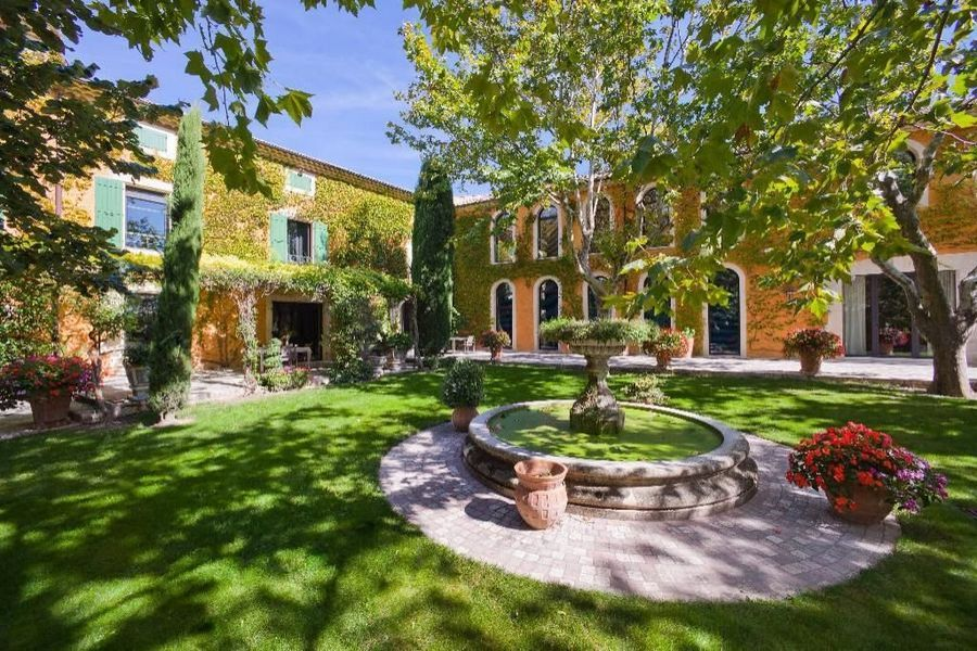 An exceptional property at the foot of the Garde Adhemar, Provence one of the most beautiful villages in France! 19th Century 6 bedroom country house entirely reformed preserving its natural authentic charm. Wonderful!