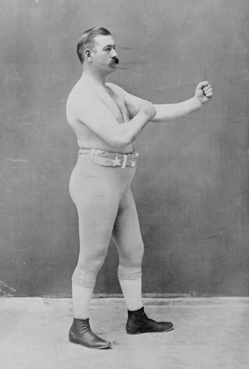 c. 1898: The great John L Sullivan with quite possibly the best mustache of all time (and one hell of an awesome hairdoo)! (Gentle)manliness defined?!