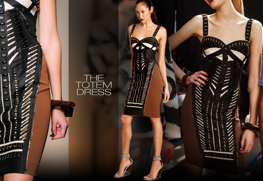 THE TOTEM DRESS  A fantastic tubular dress – very to the body, long and lean. This undeniably sexy body conscious dress is built on a jersey bodice for comfort, ease and movement. This dress uses hand cut appliqué strokes of color and geometric cuts of fabric to echo and define the body in earth, black and bone. The brass and ebony wood studs give it that extra artisan beading touch.