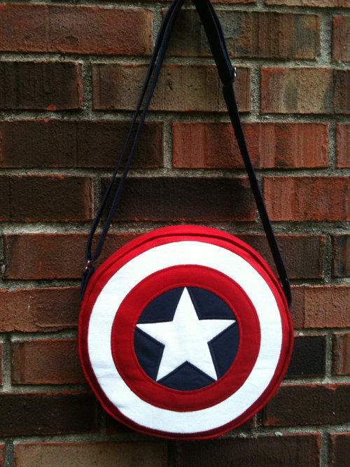 Captain America shield purse, $95, by CreoNodo. Perfect for carrying your phone, your S.H.I.E.L.D. ID badge, and your collection of vintage, near mint Captain America trading cards…