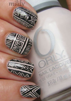 mililypolish:  Orly Decades of Dysfunction with a design free-handed by my younger sister.  She draws amazingly intricate stuff!