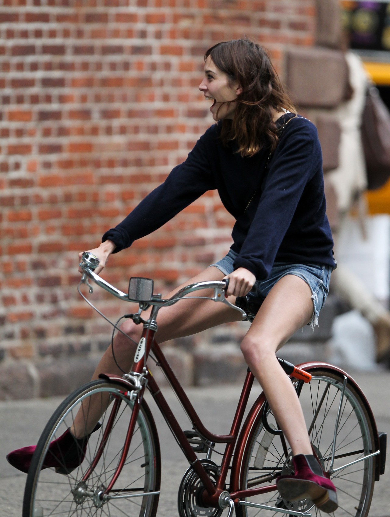 earlysunsetsovermonroeville:  Alexa Chung seen riding her bicycle after lunch with few female friends in SoHo, New York City 14 May 2012