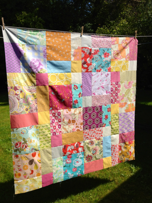 I finished piecing my 'picnic' quilt today!! The pattern is a disappearing nine-patch. Considering this quilt is for me, there's a good chance this is as far as it will go but I'm crossing my fingers that show-and-tells will inspire me to finish it!